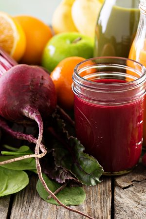 Variety of fresh vegetable and fruit juices in bottles and mason jar